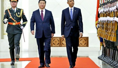 Xi walks next to Obama as they inspect the honour guards during a welcoming ceremony at the Great Hall of the People in Beijing