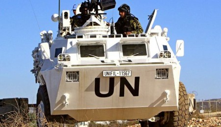 United Nations Interim Force in Lebanon (UNIFIL) troops patrol on their military vehicles in the town of Naqoura, in southern Lebanon near the border between Lebanon and Israel