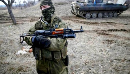 A Ukrainian serviceman is pictured at his position near Debaltseve