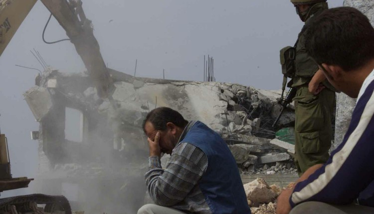 1511901052_a-palestinian-man-cant-look-as-his-home-is-demolished1