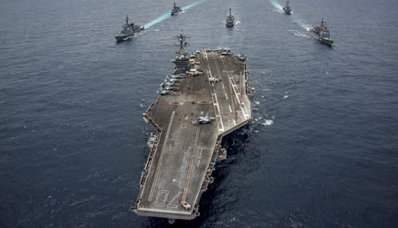 Japanese and U.S. Navy ships accompany the aircraft carrier USS Carl Vinson in the Philippine Sea