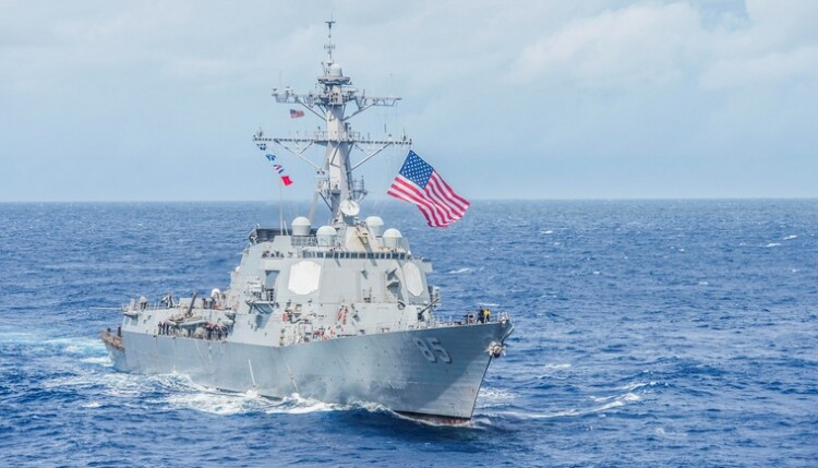 The U.S. Navy guided-missile destroyer USS McCampbell breaks away from a formation with ships in the Philippine Sea
