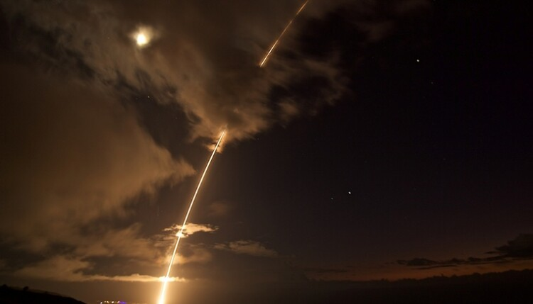 A medium-range ballistic missile target is launched from the Pacific Missile Range Facility, before being successfully intercepted by Standard Missile-6 missiles fired from the guided-missile destroyer USS John Paul Jones, in Kauai